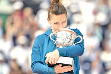 Simona Halep (ROU) poses with the trophy after her women's final match against Sloane Stephens (USA) on day 14 of the 2018 French Open at Roland Garros on Saturday.