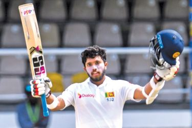 Kusal Mendis of Sri Lanka celebrates his century during day 5 of the 1st Test between West Indies and Sri Lanka at Queen's Park Oval, Port of Spain, Trinidad, on June 10. AFP