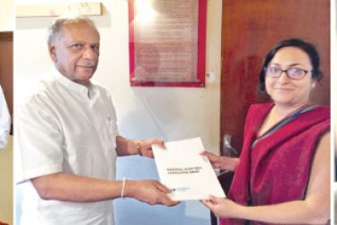 Attorney-at-Law Maheshi Herat, the author of the legislative brief, presented the document to Finance State Minister Eran Wickramaratne,(L) MP Sunil Handunnetti, Chairman of the Committee on Public Enterprises (C) and MP Dinesh Gunawardena, Leader of the Joint Opposition Parliamentary Group.
