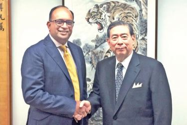 Sunshine Holdings Group Managing Director Vish Govindasamy with SBI Holdings President and CEO Yoshitaka Kitao after the successful conclusion of the private placement in Tokyo on July 3rd, 2018