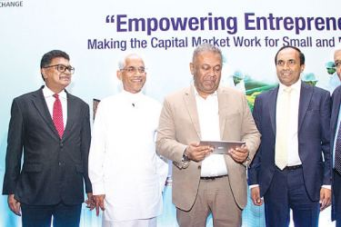Finance and Media Minister Mangala Samaraweera, State Minister of Finance Eran Wickramaratne, Chairman Securities and Exchange  Commission Ranel Wijesinha and CEO Colombo Stock Exchange, Rajeeva Bandaranaike after launching  'Empower the Small and Medium Enterprise (SME) Board at the BMICH yesterday. Picture by Sulochana Gamage