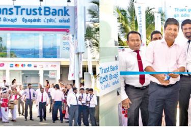 K I R D Dhammika Nandisena, Owner of Hansagiri Group and Priyantha Wijesekara, Executive Vice President – Leasing, Nations Trust Bank cuts the ribbon at the opening.