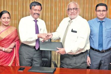 Jegan Durairatnam, CEO of Commercial Bank exchanges the agreement with Kapila Jayawardena, Group Managing Director/CEO – LOLC Group. Also in the picture is Kalsha Amarasinghe, Executive Director, LOLC Group.