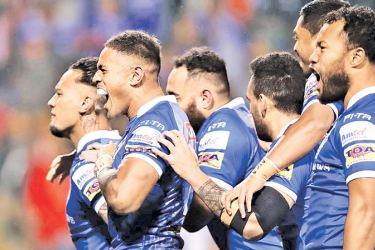 Samoan players celebrate their qualification to the 2019 Rugby World Cup.