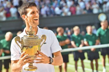 Serbia's Novak Djokovic holds the winners trophy after beating South Africa's Kevin Anderson 6-2, 6-2, 7-6 in their men's singles final match on the thirteenth day of the 2018 Wimbledon Championships at The All England Lawn Tennis Club in Wimbledon, southwest London, on July 15. AFP