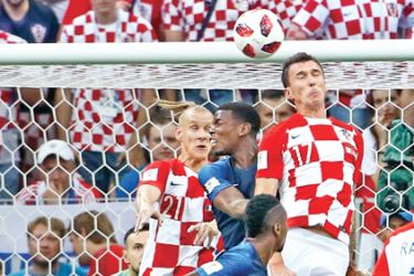 The ball goes in off of Croatia's forward Mario Mandzukic's head for the opening goal during the Russia 2018 World Cup final football match between France and Croatia at the Luzhniki Stadium in Moscow on July 15. AFP