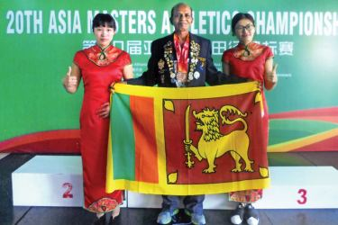K M Karunaratne at the 20th Asian Masters Athletic Championship held in China. He was adjudged the best Sri Lankan Athlete at this meet. (Picture by H L Sunil Shantha – Kalutara Central Special Correspondent)