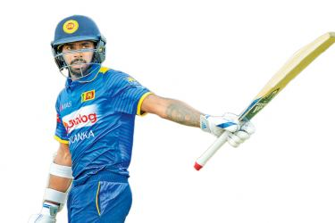 Niroshan Dickwella dedicated his half century to his sister who celebrated her birthday on Wednesday. - AFP