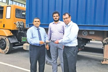 Convenience Foods (Lanka) officials with the consignment of Lankasoy