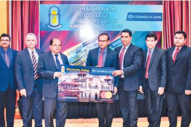 Commercial Bank Chairman Dharma Dheerasinghe presents a replica of the Affinity Card to the President of the Dharmaraja College OBU Priyantha Abeykoon and Vice President Dhananjaya Panangala.