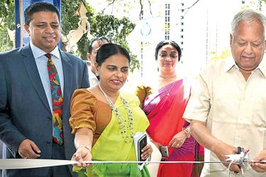 Minister Dr. Sarath Amunugama opening the new building at the Ocean University of Sri Lanka while others look on.
