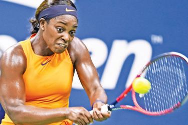Sloane Stephens of the US returns the ball to Belgium's Elise Mertens during their women's singles tennis match on Day 7 of the 2018 US Open at the USTA Billie Jean King National Tennis Center on September 2, in New York City. / AFP