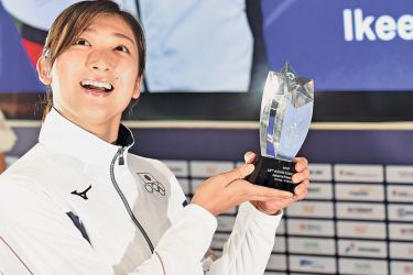 """Japan's swimmer Ikee Rikako, who won six gold medals during the games, poses after being named as the """"Most Valuable Player (MVP)"""" at an awards ceremony for the 18th Asian Games in Jakarta on Sunday. - AFP"""