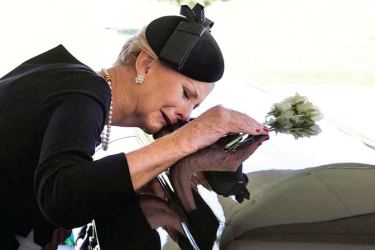 Cindy McCain lays her head on the casket of her husband Sen. John McCain during a burial service  at the US Naval Academy in Annapolis, Maryland on Sunday.