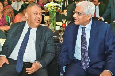 Minister Mangala Samaraweera and Governor of the Central Bank, Dr. Indrajit Coomaraswamy at the event