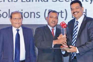 Officials of Certis Lanka Security Solutions receive the award.