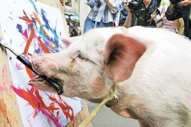 A pig called Malevich showing off his painting skills in downtown Moscow