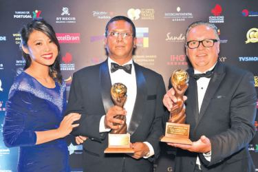 SriLankan Airlines Manager Hong Kong,  Pradeep Durairaj  with  WTA officials after receiving the awards.