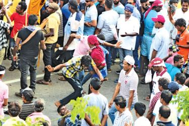 The Joint Opposition's much heralded protest march yesterday was marred by violence,rowdiness and drunkenness. According to officials, 81 people who had passed out from intoxication had been rescued by the 1990 ambulance service and taken to hospital.