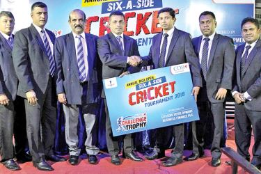 Presentation of sponsorship for MCA Open Sixes tournament: Director/ Chief Credit Officer, Sasindra Munasinghe (3rd from right) handing over the sponsorship package to President /MCA, Roshan Iddamalgoda (4th from left). Others in the picture from left: Sujeewa de Silva, Chairman, Tournament Committee, Rohana Dissanayake, VP & Chairman Sponsorship Committee, Nalin Wickremasinghe, General Secretary (all three from MCA), Senior Deputy Manager, Innovation & Intelligence, Hasitha Dasanayake & Dharshana Jayasingh