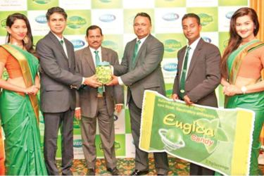 Praveen Viswakumaran, Country Manager Mega Lifesciences hands the Eugika Candy for distribution to Nishantha Weerasinghe, Director A. Baur & Company.