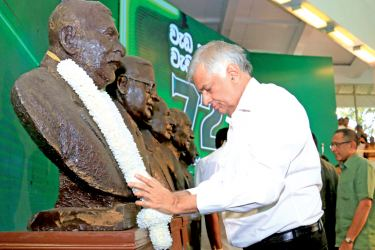 Prime Minister Ranil Wickremesinghe garlanding the bust of UNP founder and Father of the Nation,  Rt. Hon. D.S.Senanayake at the 72nd anniversary celebrations held at the Party headquarters  Sirikotha yesterday. Picture by Hirantha Gunathilake.