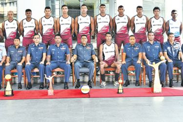The SLAF volleyball team poses for a picture with the officials before leaving for Bangladesh.