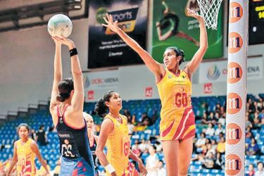 Sri Lanka Goal Attacker Goal Attack Gayani Dissanayake thwarts an attempt by a Hong Kong player to score in their Asian Netball Championship match played at Singapore yesterday.