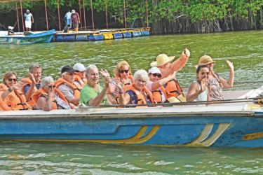 Tourists in Maduganga.  Picture by Wimal Karunathilake