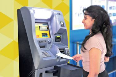 A depositor uses the fully-automated cheque deposit machine.