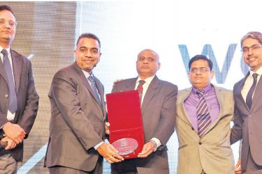 M.N Nowfell, MD Built-Mech receives the award from  Arun Bhatia, Managing Director, UTC Climate, Controls & Security – India Region.