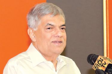 Prime Minister Ranil Wickremesinghe speaks at the Puttalam District UNP Bala Mandala meeting in Chilaw on Saturday.