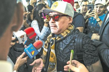 Diego Maradona was mobbed at Culiacan airport after he flew in to be presented as coach of Mexican second-division club Dorados. AFP