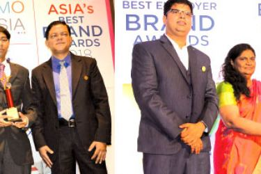 """The Bank of Ceylon's Deputy General Manager Human Resource K.E.D. Sumanasiri and Saranga Herath, Assistant Manager Human Resource at the Asia's Best Employer Brand Award Ceremony held at """"Le Meridien Singapore, Sentosa"""" with the certificate and the trophy received at the Asia's Best Employer Brand Awards 2018. Samantha Wimalasiri, Chief Manager Superannuation receiving the Award for one of the Sri Lanka's Best Employer Brands 2018"""