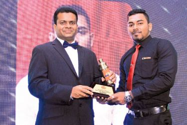 """""""Best Sales Representative winner Roshan Rangama, receiving the Gold Award from Mangala Perera Executive Director- Internal Trading of C.W.Mackie PLC at Scan Annual Sales Conference 2017/18 held at Hotel Club Palm Bay - Marawilla""""."""