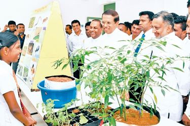 President Maithripala Sirisena speaking to a student. Picture by President's Media.