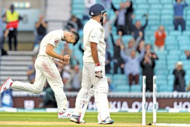 England's James Anderson (L) celebrates after taking the wicket of India's Mohammed Shami on the final day of the fifth Test cricket match between England and India at The Oval in London on September 11, 2018. - The match ended when James Anderson became the most successful fast bowler in Test history when he bowled Mohammed Shami for his 564th Test wicket, breaking the record he had shared with Australia's Glenn McGrath.