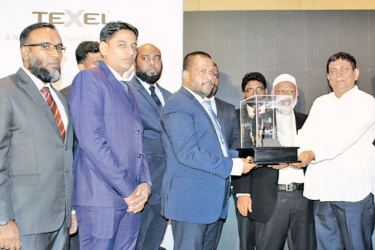 Minister of Trade and Commerce, Rishad Badurdeen  with other officials at the event