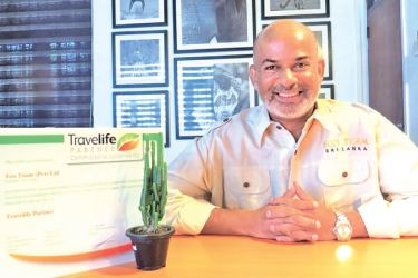 Anuruddha Bandara, CEO/ Founder poses with the Travel Life certification