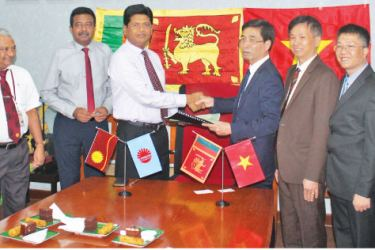 Ceylon Electricity Board and Rang Dong Light Company officials at the event