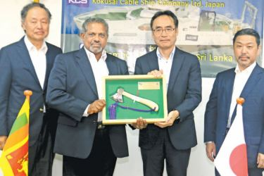 "D.V. Abeysinghe MD/CEO Colombo Dockyard PLC presenting the symbolic axe used to launch the Cable Laying Vessel ""KDDI CABLE INFINITY"", flanked by Dr. Toru Takehara Chairman CDPLC and Yukihiro Fujii Managing Director KCS"