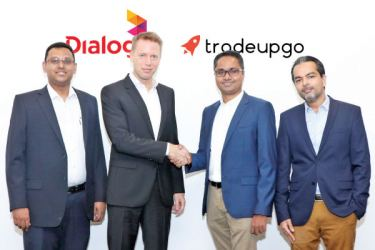 Ayomal Gunasekera, Head of Device Business, Mobile Telecommunications, Dialog Axiata PLC, Dr. Rainer Deutschmann, Group Chief Operating Officer, Dialog Axiata PLC, Chamika Godamanna, Managing Director, Stelacom and Vishal J. Bakshani, Director, Tradeupgo