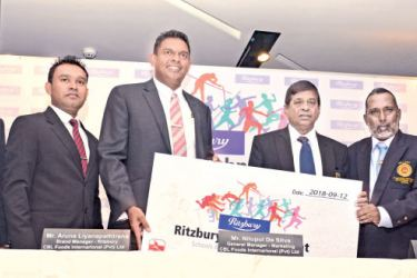 The sponsorship cheque being handed over by General Manager – Marketing, CBL Foods International (Pvt) Ltd Nilupul de Silva (third from left) to Secretary of Sri Lanka Schools Athletic Association Neville Rodrigo (fifth from left). From left Manager – Public Relations CBL Foods Janaka Boteju, Ritzbury Brand Manager Aruna Liyanapathirana, Special Advisor (Sports) – Ministry of Education Sunil Jayaweera and Vice President of SLSAA K.G. Fernando also in the picture. Picture by Ranjith Asanka