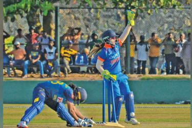 Sri Lanka Women's Inoka Ranaweera is stumped by India Women wicket-keeper Taniya Bhatia in the second Women's ODI played at Galle International Stadium yesterday.