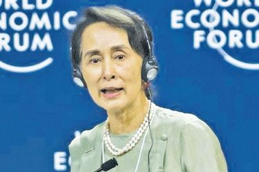 Myanmar State Counsellor Aung San Suu Kyi speaks at the World Economic Forum on Asean in Hanoi on Wednesday. - AFP