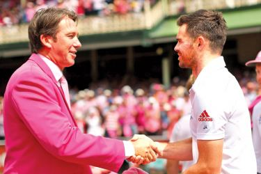 Glenn McGrath congratulates James Anderson after the England fast bowler broke the Australian's bowling record of 563 wickets in the fifth and final Test against England at the Oval.