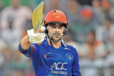Afghanistan's Rashid Khan celebrates his fifty on his 20th birthday in the Asia Cup match against Bangladesh at Abu Dhabi on Thursday. - AFP