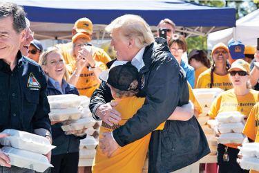 While handing out meals to Hurricane Florence victims in New Bern, North Carolina, US President Donald Trump got a special request — a hug from a young boy who was helping out. Trump obliged.