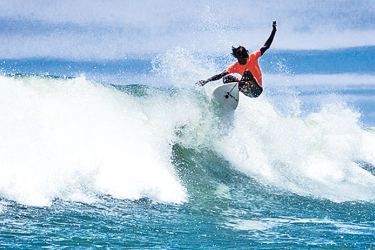 Lesitha riding a wave during the first surfing Nationals