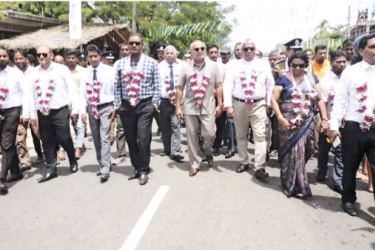 Chief Guest Minister Rauff Hakeem and other guests on parade